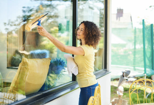 cleaning windows with squeegee